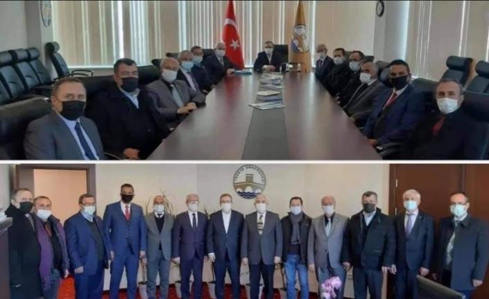MHP İl Başkanı Tercan ve yönetim kurulu üyeleri, Rektör Tabakoğlu'nu ziyaret etti
