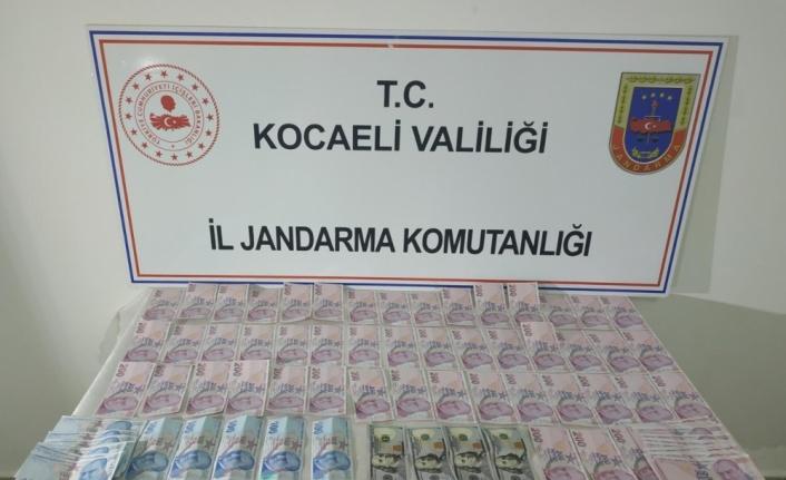 Kocaeli'de piyasaya sahte para sürmeye çalışan 9 şüpheli yakalandı