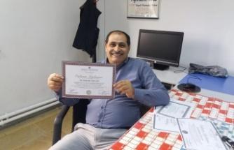 Aydemir Özcan, 50. yaş gününde Üniversiteden mezun oldu