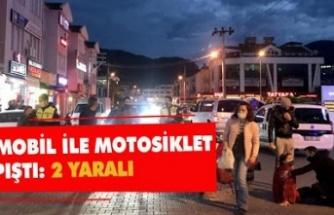 Otomobille çarpışan motosikletteki iki kişi yaralandı